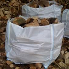 Logs in cubic metre bags ready for despatch to customers.
