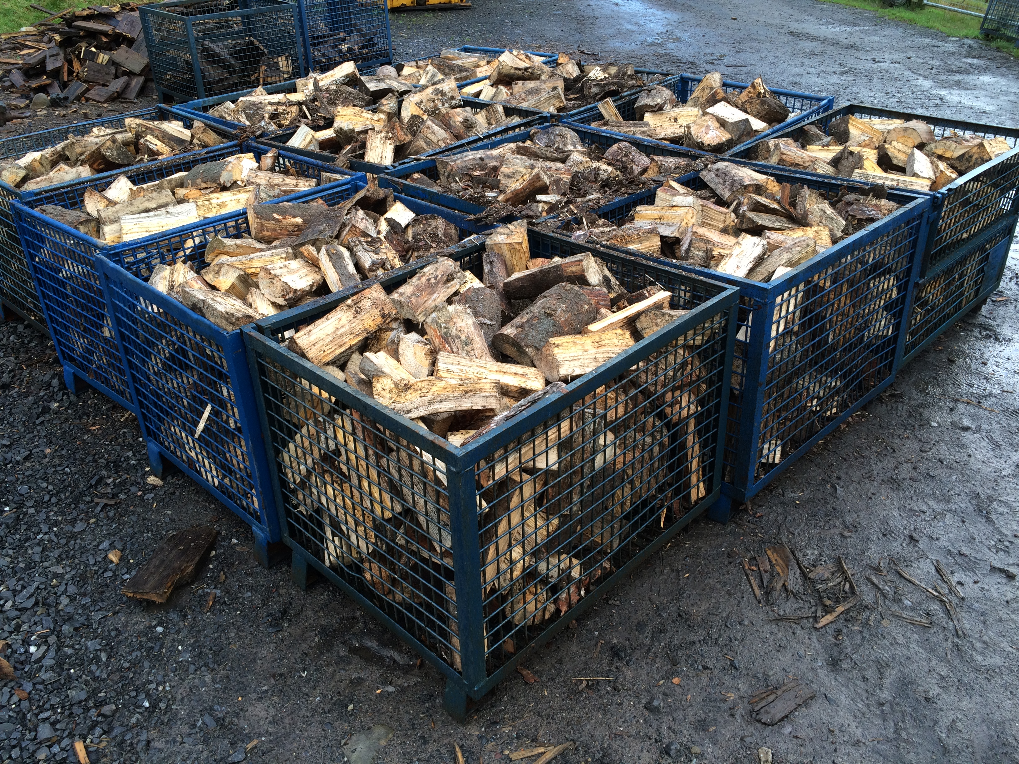 Logs in baskets ready for the kilns.